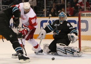 Back in the office: Tomas Holmstrom sticks his rear end in a goalie's face.